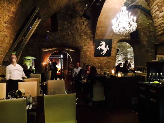 Dining in an elegant cave below busy Prague Square
